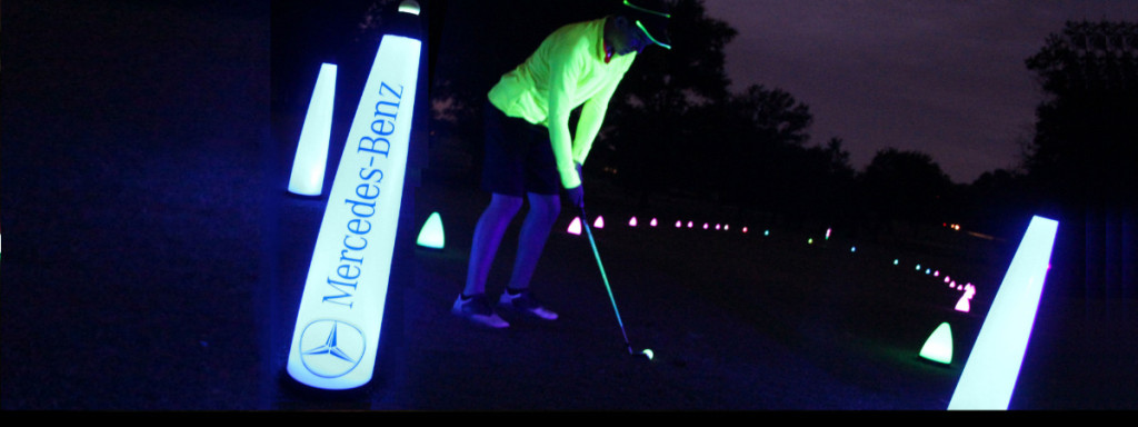 night golf player at tee box shot