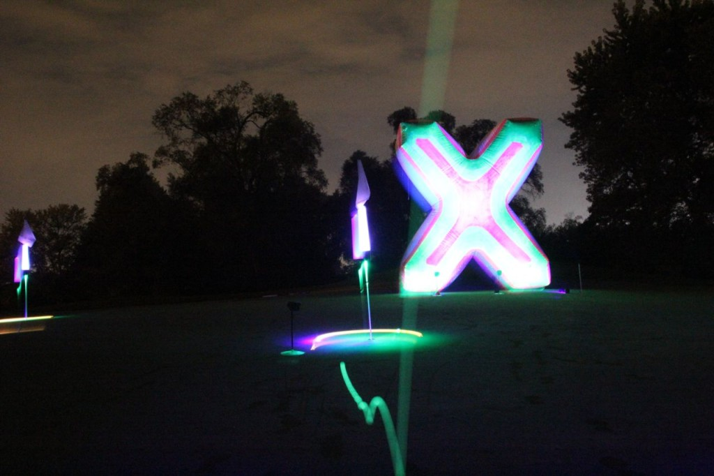 giant X night golf shot