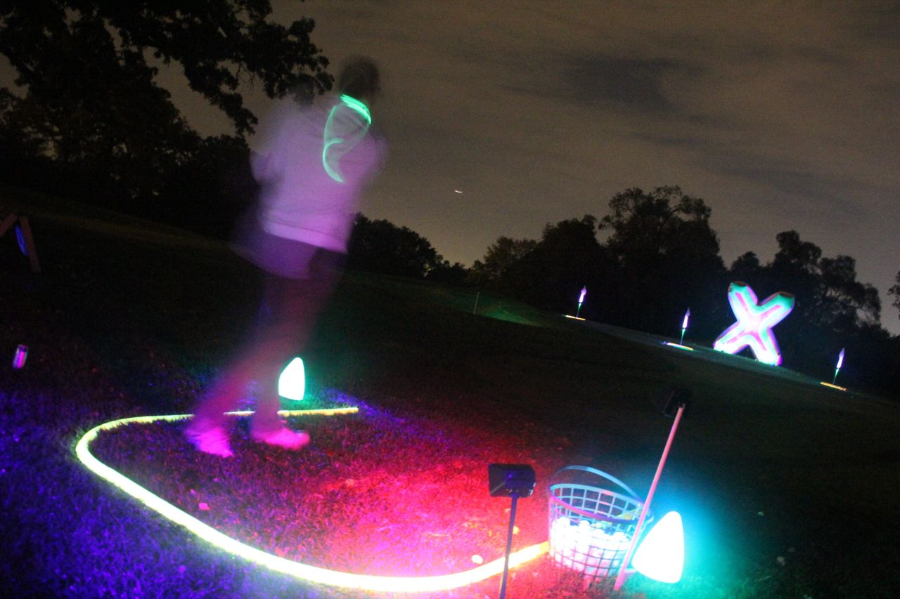 night golfing fun outside