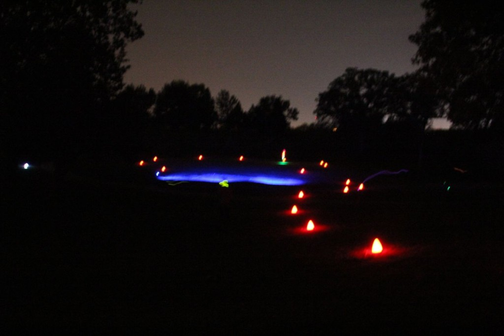 glow in the dark golf hole at night